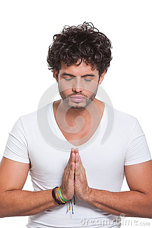Young man with hands in prayer