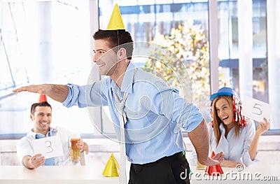Young man having fun at office party