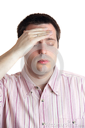 Young man with headache on white