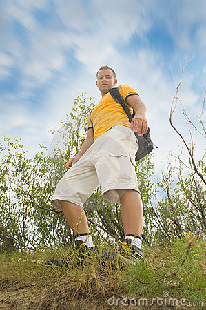 Young man hiker on the hill