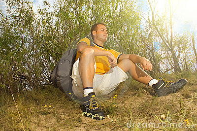 Young man hiker relaxing on the hill