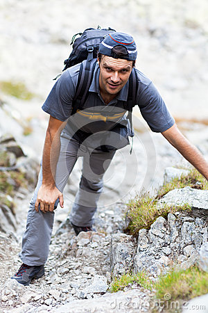Young man hiking on mountain trail