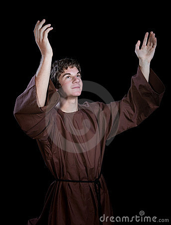 Young Man With his Arms Lifted in Praise