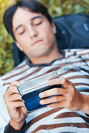 Young man with his pocket computer