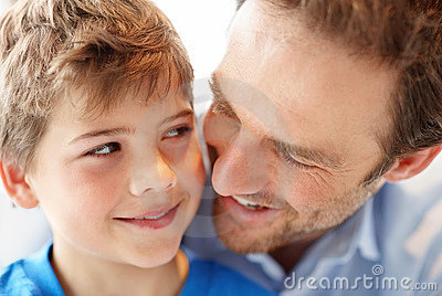 Young man and his son looking at each other