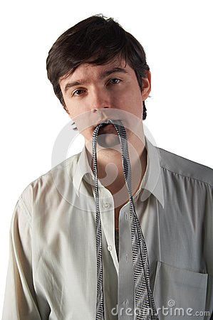 Young man hold necktie in teeth