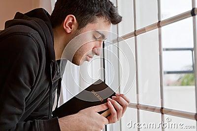 Man Praying by Window