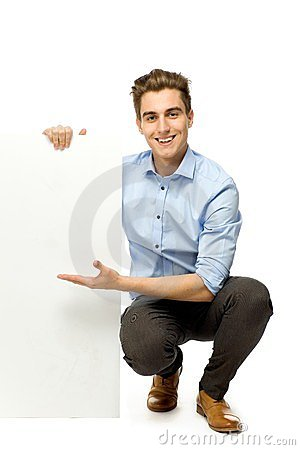 Young man holding blank board