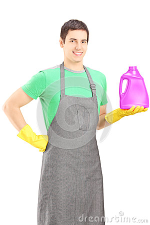 Young man holding a bottle of cleaning liquid
