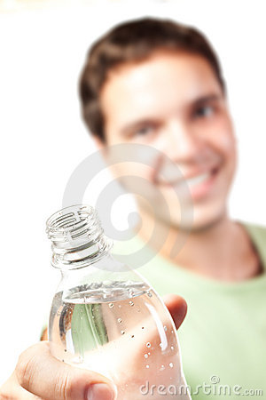 Young man holding bottle of water isolated