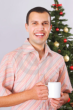 Young man holding cup with tea