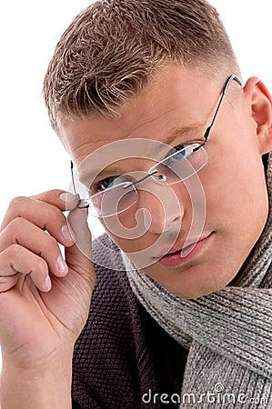Young man holding eyewear