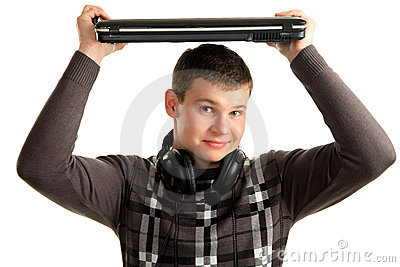 Young Man holding a laptop in over his head