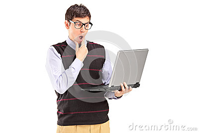 Young man holding a laptop and thinking