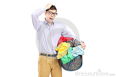 Young man holding a laundry basket and gesturing