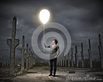 Young man holding a light