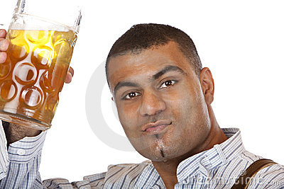 Young man holding Oktoberfest beer stein in hand