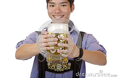 Young man holding Oktoberfest beer stein (Mass)