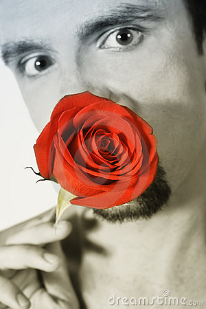 Young man holding a red rose
