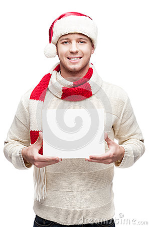 Young man holding in santa hat sign