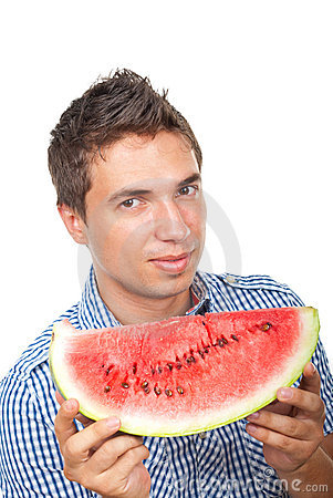 Young man holding a slice of watermelon