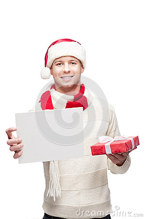 Young man holding small christmas gift and sign