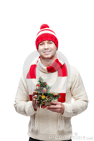 Young man holding small christmas tree