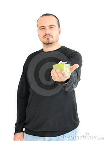 Young man holding small gift(focus on gift)