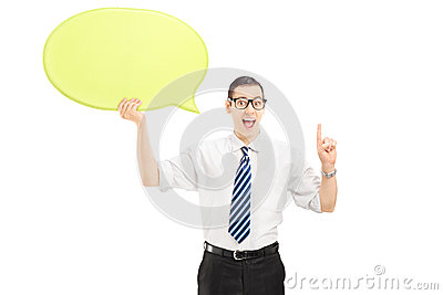 Young man holding a speech bubble and gesturing with his finger