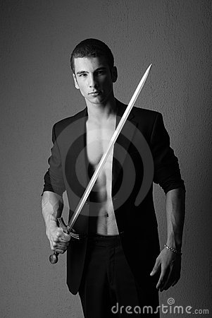 Free Young Man Holding Sword Royalty Free Stock Photos - 9845798