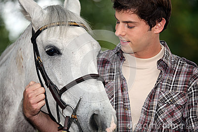 Young man with a horse