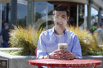 Young man with a hot drink