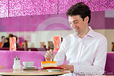 Young man in ice cream parlor