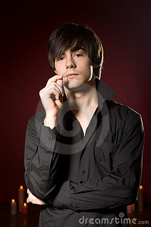 Free Young Man In Black Shirt On Red Background Royalty Free Stock Photos - 12167628