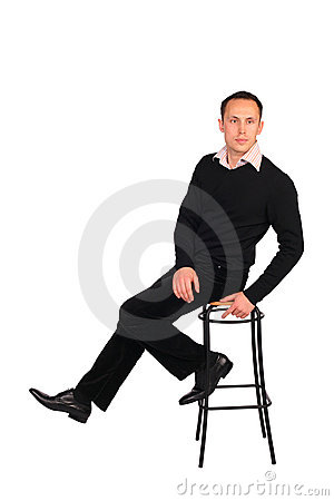 Free Young Man In Black Sits On Stool Royalty Free Stock Images - 4674879