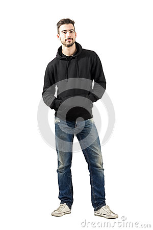 Free Young Man In Hoodie With Hands In Pockets Smiling At Camera Royalty Free Stock Photos - 47697558