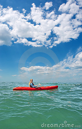 Free Young Man In Sea Kayak Under Dramatic Skies Royalty Free Stock Images - 6865099