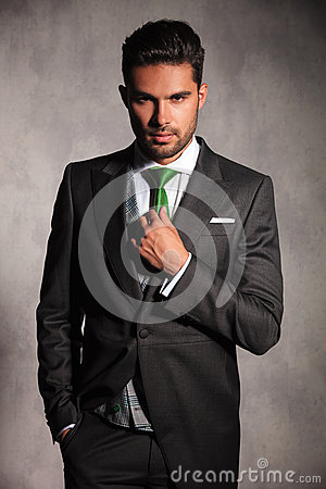Free Young Man In Tuxedo Coat Fixing His Green Tie Stock Image - 86069731
