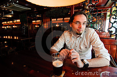 Young man in an irish bar