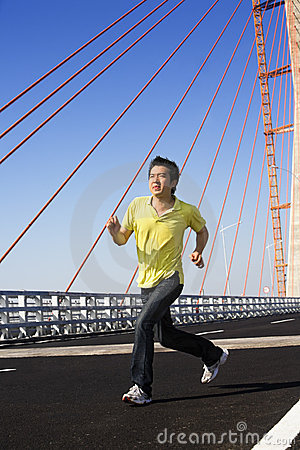 Young man jog in bridge area