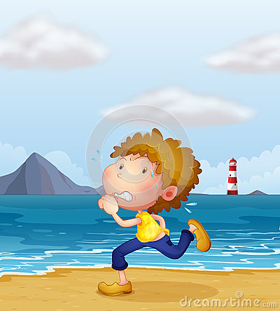 A young man jogging along the beach