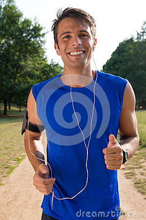 Young Man Jogging While Listening Music