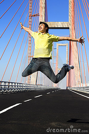 Young man jump very high in bridge area