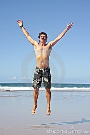 Young man jumping in the air out of joy