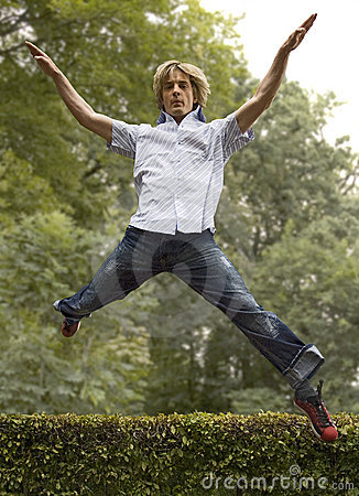Young man jumping in forest