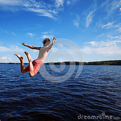 Free Young Man Jumping Into Water Royalty Free Stock Image - 69894616