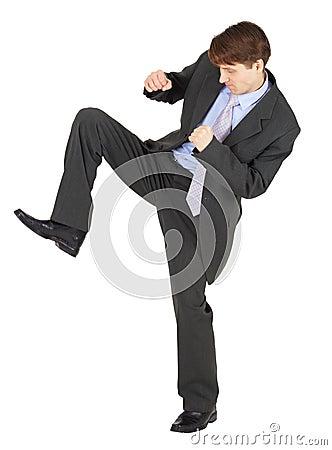 Young man kicks