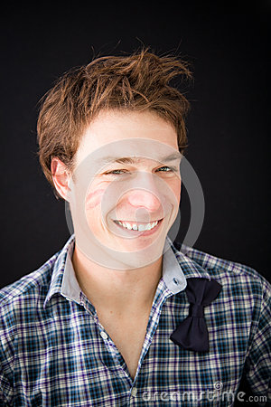 Young man with kiss trace on the cheek