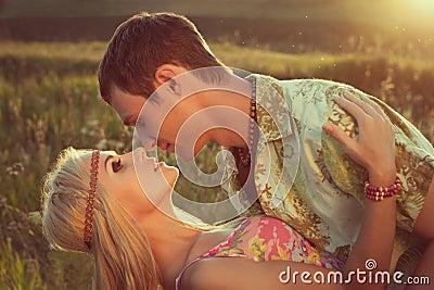 Young man kisses beautiful woman