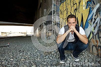 Young Man Kneeling